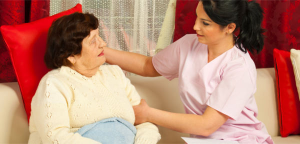 caregiver taking care of the elder woman